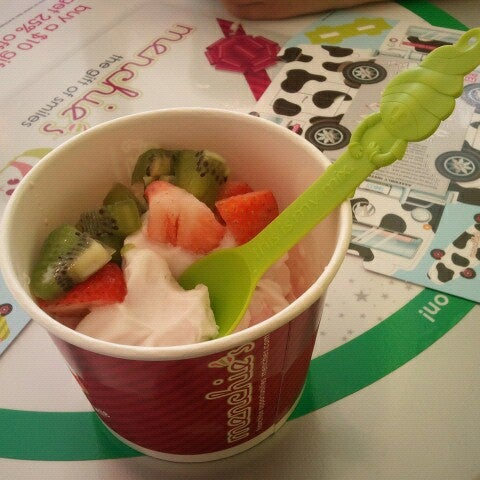 Photo taken at Menchie's Red Bug Village by Kaitlyn K. on 12/9/2012