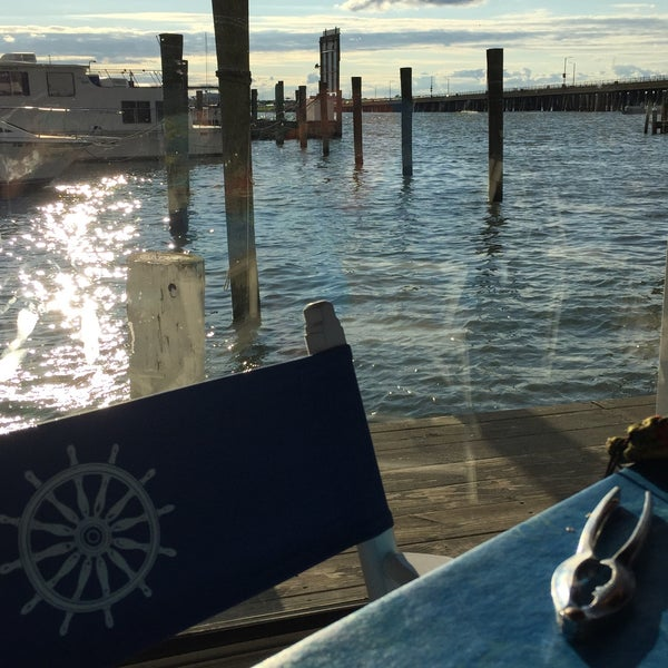 Photo taken at Marina Deck Resturant by Nicole W. on 6/28/2015