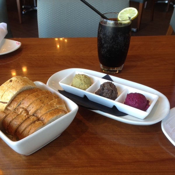 Photo taken at Glow Restaurant by Gazalle on 9/27/2014