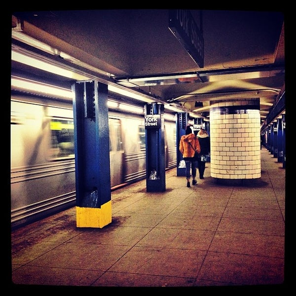 Photo taken at MTA Subway - York St (F) by *Bitch Cakes* on 3/8/2014