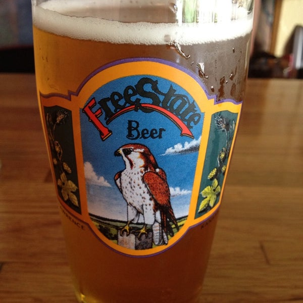 Photo taken at Free State Brewing Company by Travis G. on 7/24/2013