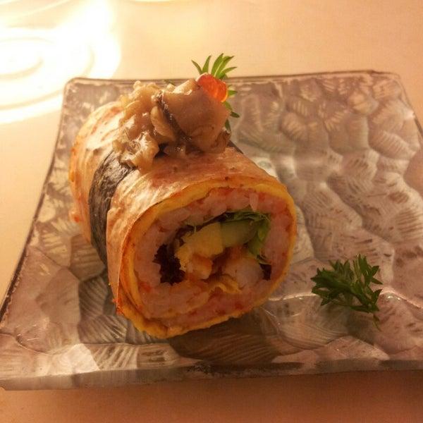 Photo taken at Sakae Sushi by Mila L. on 6/10/2013