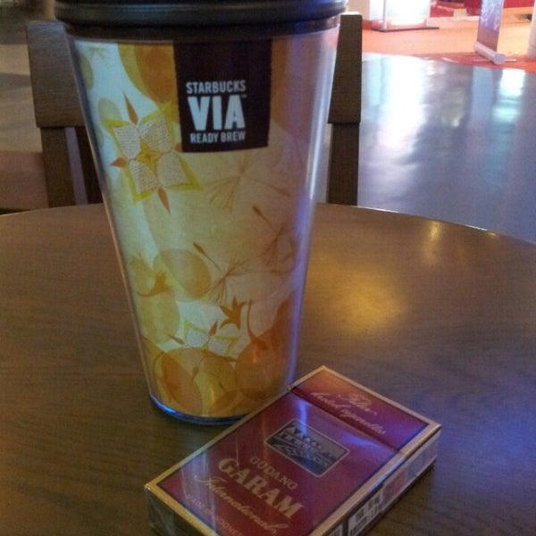 Photo taken at Starbucks by erfan v. on 4/21/2013
