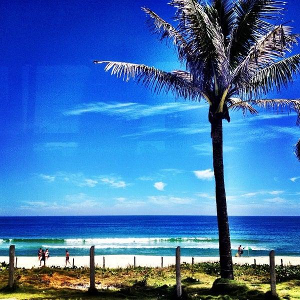 Photo taken at Praia da Barra da Tijuca by Fabio M. on 12/18/2012