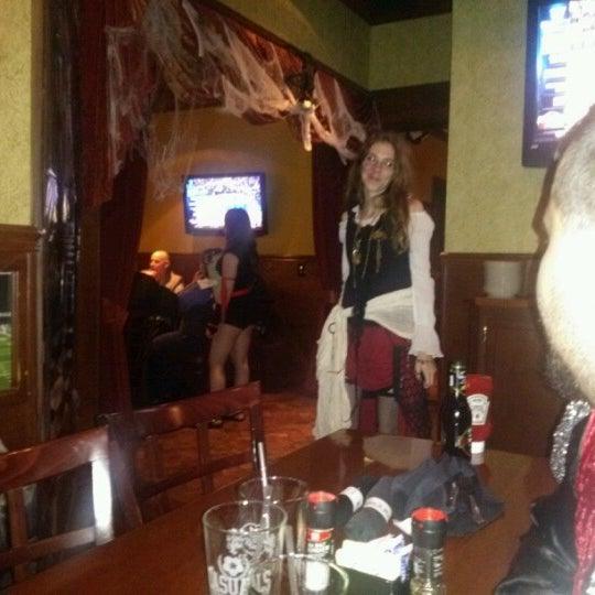 Photo taken at The Lion & Rose British Restaurant & Pub by Chris H. on 11/1/2012
