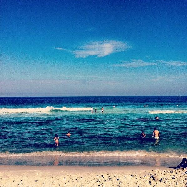 Photo taken at Praia da Barra da Tijuca by Denise on 7/14/2013