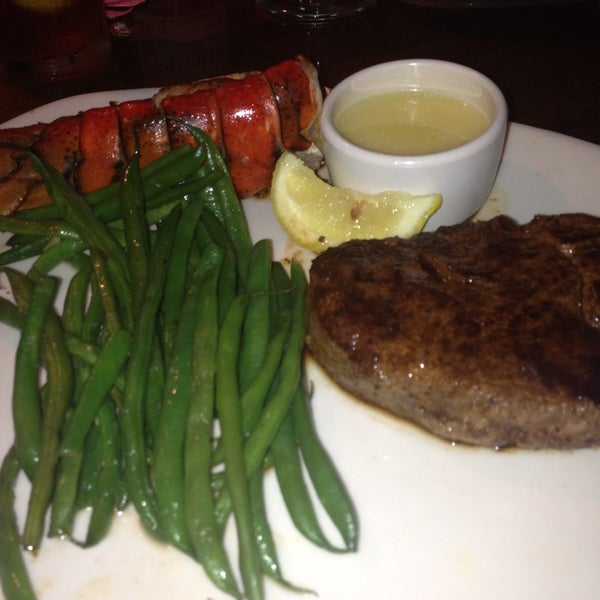 Photo taken at Outback Steakhouse by April G. on 6/29/2013