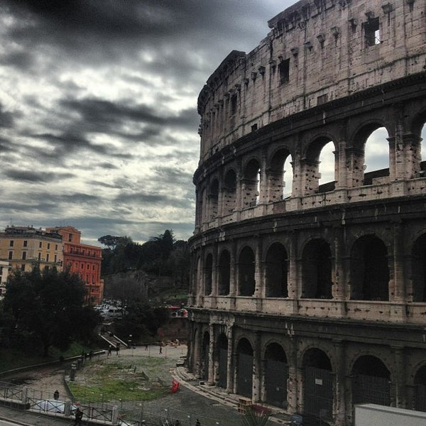 Photo taken at Piazza del Colosseo by Pascual V. on 3/15/2013