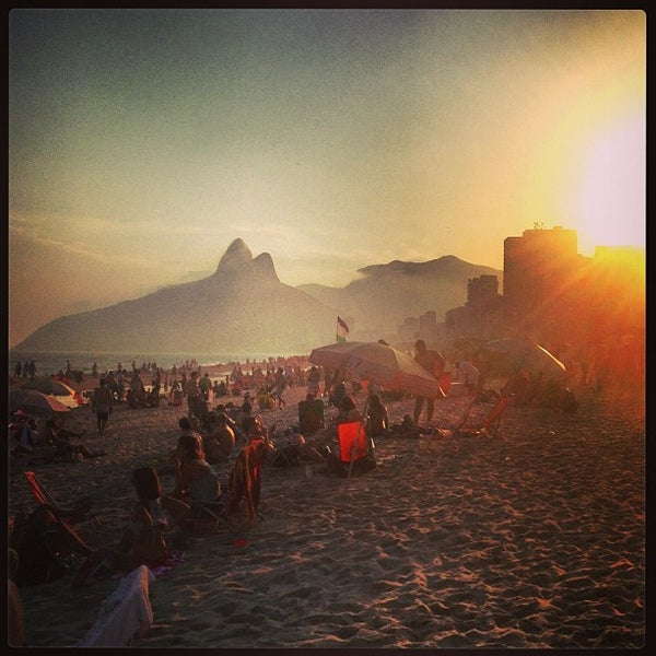 Photo taken at Ipanema Beach by Hick G. on 5/5/2013