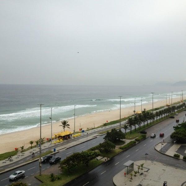 Photo taken at Praia da Barra da Tijuca by Rafaela M. on 3/2/2013