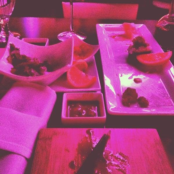 Photo taken at PNK Restaurant & Ultra Lounge by Kambiz S. on 1/3/2013