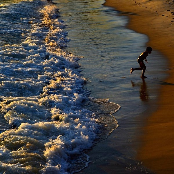 Photo taken at Praia da Barra da Tijuca by Thiago D. on 12/19/2012
