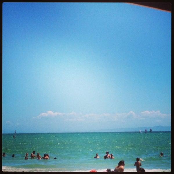 Photo taken at Playa El Yaque by Angela R. on 8/10/2013