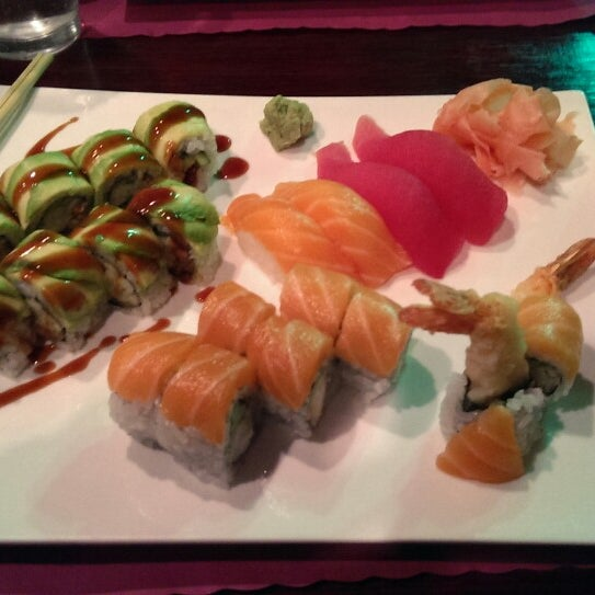 Photo taken at Sushi Cafe by Stef R. on 1/31/2014