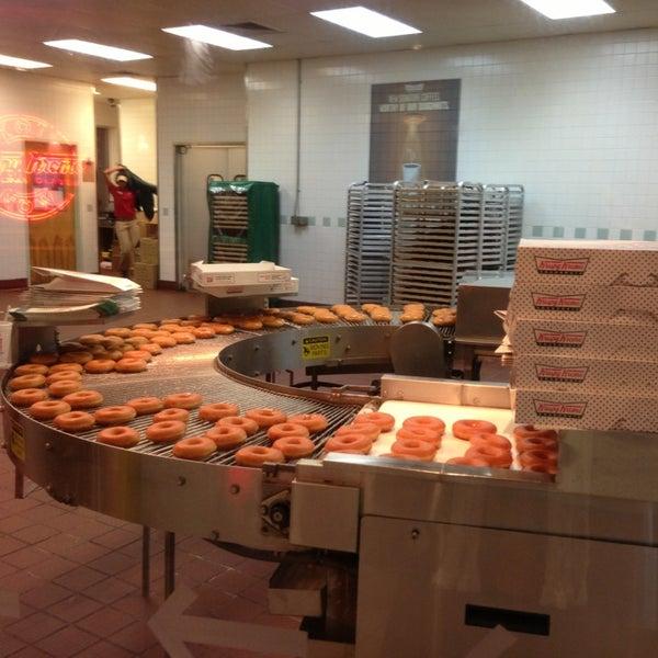 Photo taken at Krispy Kreme Doughnuts by Jenna Lynn C. on 1/20/2013