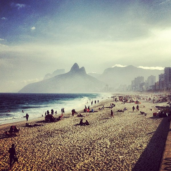 Photo taken at Ipanema Beach by Marcelo B. on 7/19/2013