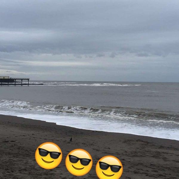 Photo taken at Aberystwyth Beach by Nureen H. on 2/16/2016