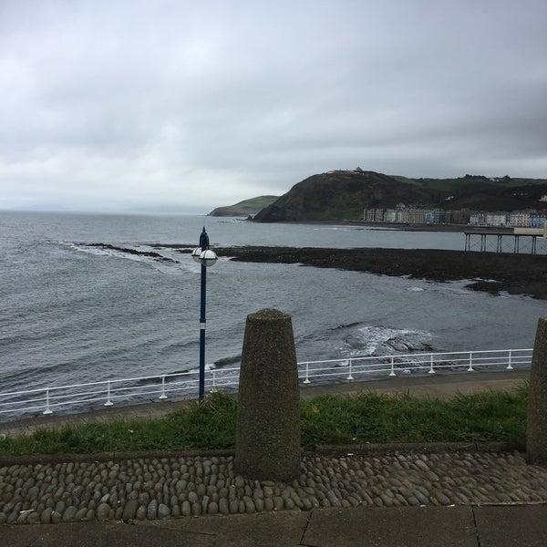 Photo taken at Aberystwyth Beach by Nureen H. on 10/26/2016