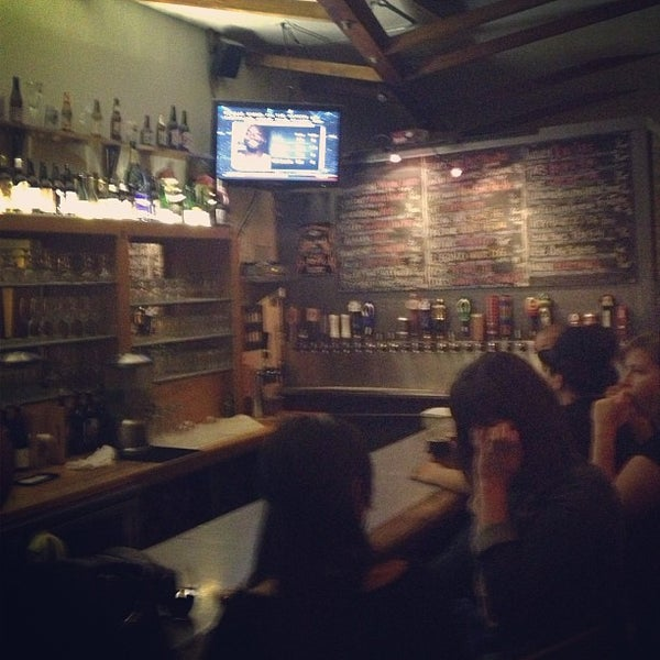Photo taken at The Library Alehouse by Ashley G. on 3/28/2013