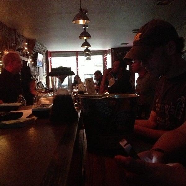 Photo taken at Double Wide Bar & Southern Kitchen by Jennifer K. on 7/3/2013