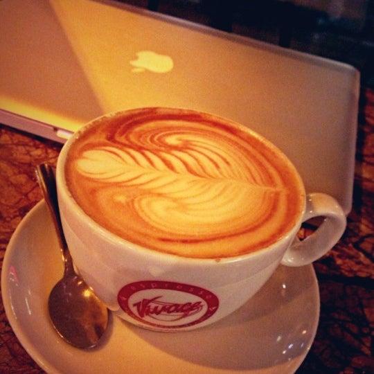 Photo taken at Espresso Vivace by Daniel on 12/14/2012