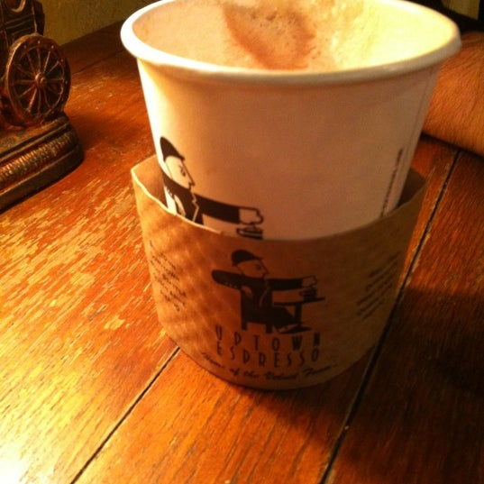Photo taken at Uptown Espresso by Jessica on 10/23/2012