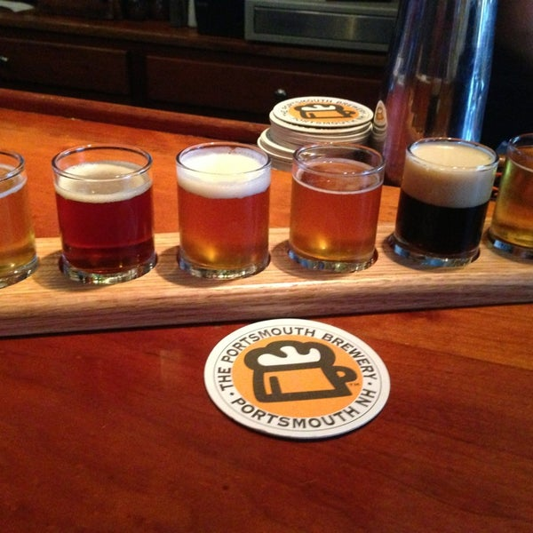 Photo taken at Portsmouth Brewery by Julie F. on 6/28/2013