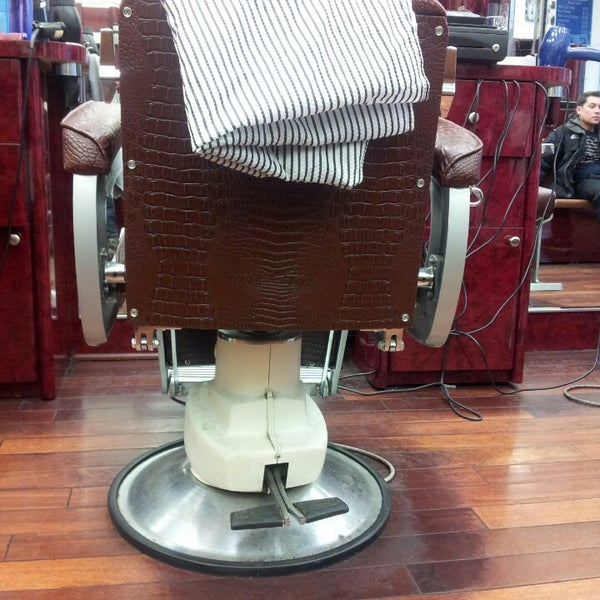 Photo taken at Manhattan Barber Shop by Ric K. on 4/19/2014