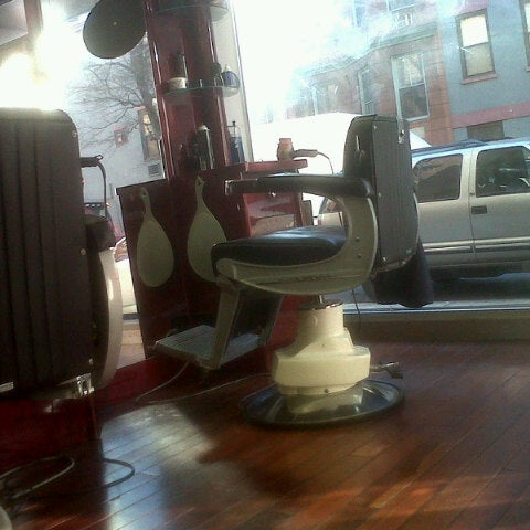 Photo taken at Manhattan Barber Shop by Ric K. on 1/19/2013