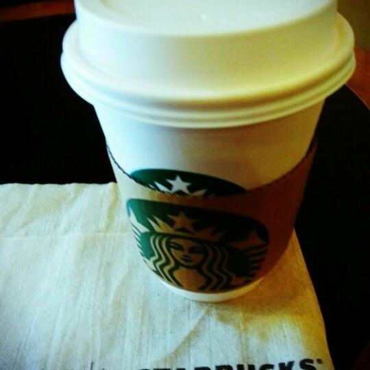 Photo taken at Starbucks by YOD on 2/10/2013
