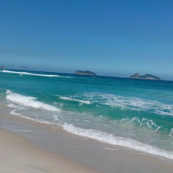 Photo taken at Praia da Barra da Tijuca by Gustavo M. on 6/5/2013