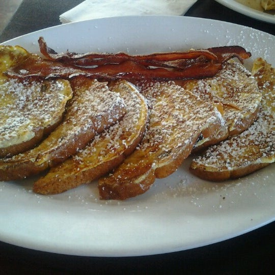 Photo taken at Village Bread Cafe by Paula D. on 10/6/2012