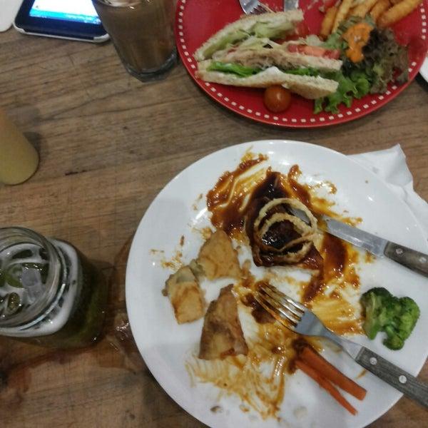 Photo taken at JAVA BEAN Coffee & Resto by Tya K. on 1/6/2014
