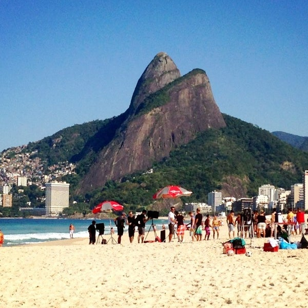 Photo taken at Ipanema Beach by Isabella P. on 7/19/2013