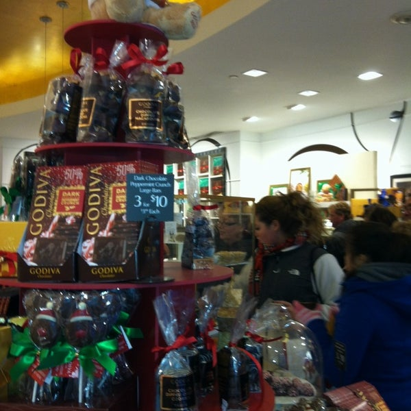 Photo taken at Godiva Chocolatier by Melanie on 12/7/2013