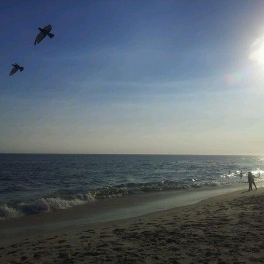 Photo taken at Praia da Barra da Tijuca by Eneida B. on 12/26/2012