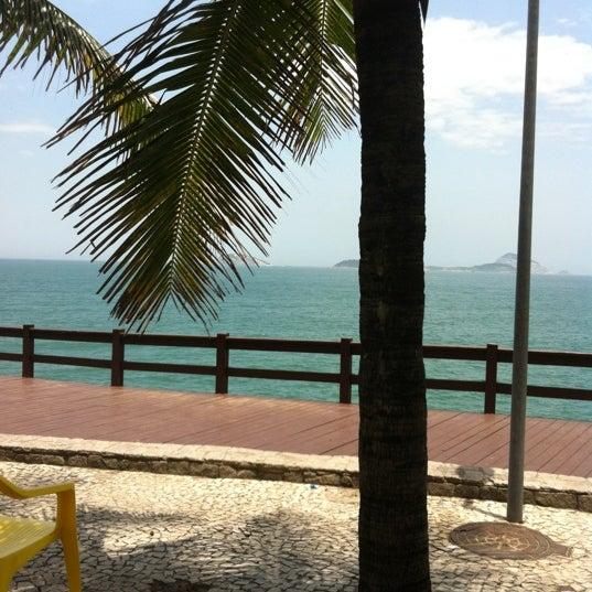 Photo taken at Praia da Barra da Tijuca by Ediane on 1/8/2013