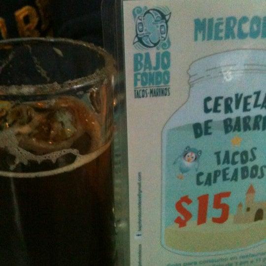 Photo taken at Bajo Fondo by Ingrid on 10/25/2012