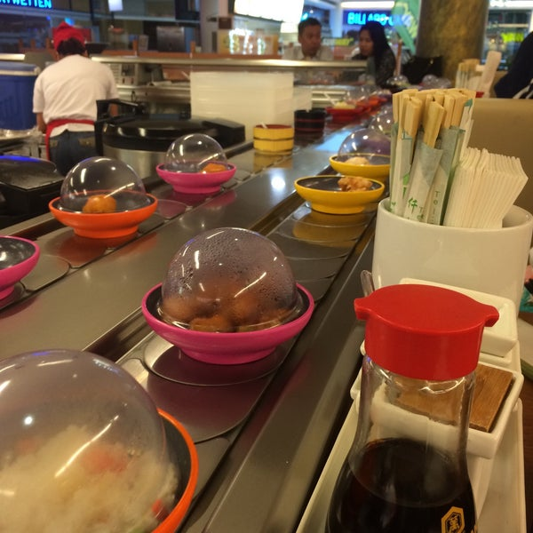 Photo taken at Okiru Running Sushi by Caroline on 8/6/2015