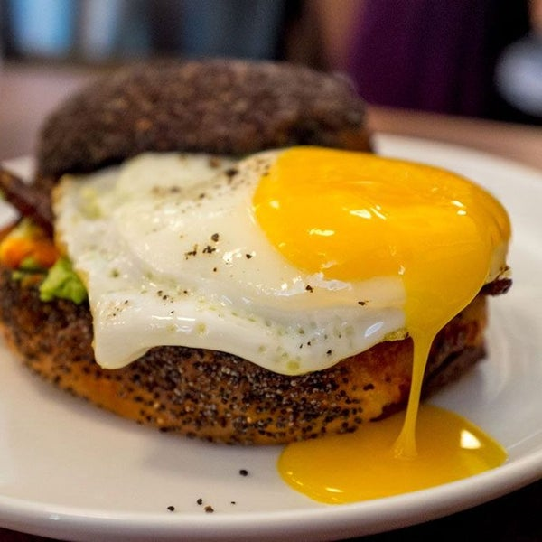 """Listed on the menu as """"egg, pancetta, and avocado sandwich,"""" Estela fails to mention arguably the best part: that the sandwich is served on a tebirke (Danish poppyseed pastry)."""