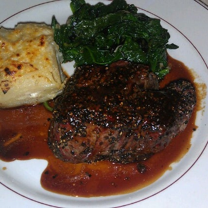 Photo taken at Rothmann's Steakhouse by Alexis N. on 12/16/2012