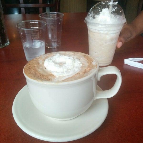 Photo taken at Arcedium Coffeehouse Inc by Omar G. on 6/7/2014