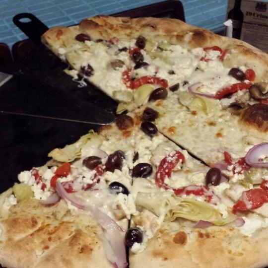 Photo taken at Tartini Pizzeria & Spaghetteria by Lisa W. on 11/3/2014