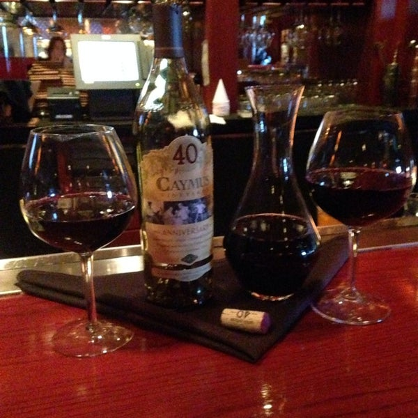Photo taken at Fleming's Prime Steakhouse & Wine Bar by Rena S. on 8/17/2014