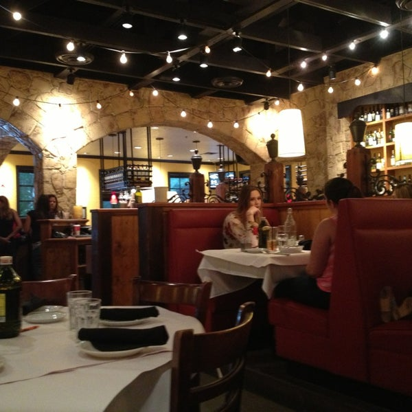 Photo taken at Romano's Macaroni Grill by Angie R. on 1/2/2013
