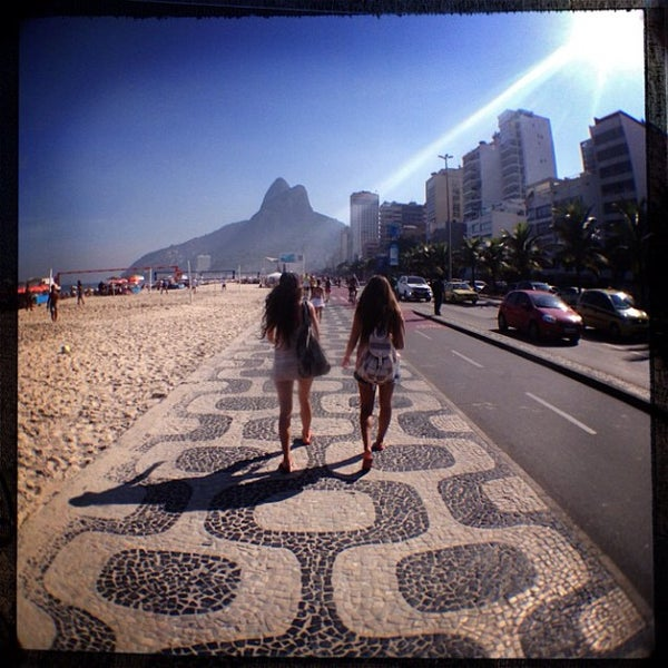 Photo taken at Ipanema Beach by Patrick F. on 5/4/2013