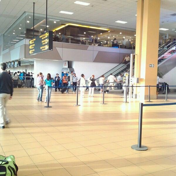 Photo taken at Jorge Chávez International Airport (LIM) by Christian V. on 4/8/2013