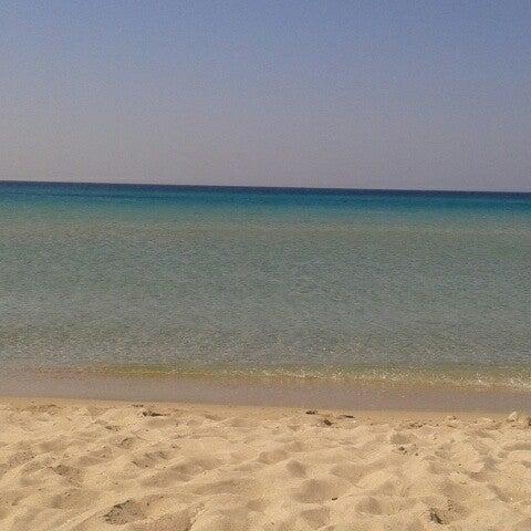 Photo taken at Ramo Beach by Sibel on 7/29/2013