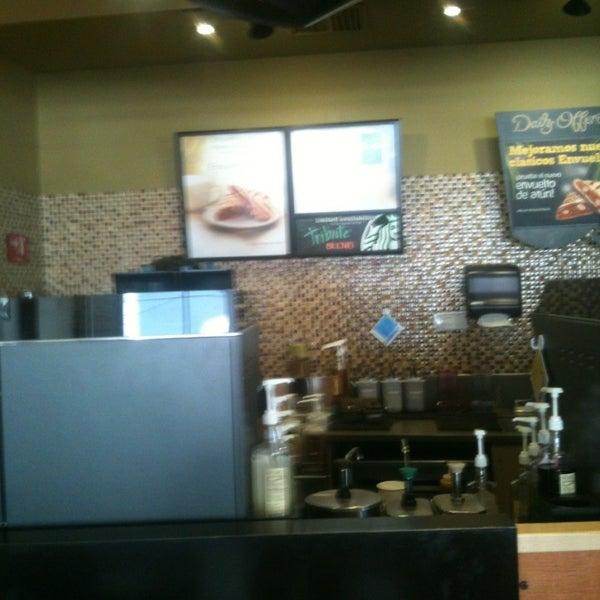 Photo taken at Starbucks by Marco Antonio G. on 3/14/2013