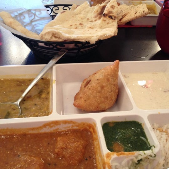 Photo taken at Saffron Indian Cuisine by Rosario R. on 10/1/2012